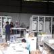 Khách hàng kiểm tra lắp đặt tủ điện điều khiển hệ thống xử lý khí thải tại xưởng Đại Thanh
